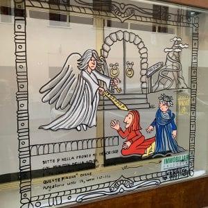 L'arte nei negozi sfitti di Tricesimo, sulle vetrine le vignette dedicate a Dante